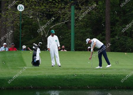 Webb Simpson takes a drop after hitting the water on the sixteenth hole during the first round of the 2021 Masters Tournament at Augusta National Golf Club in Augusta, Georgia on Thursday, April 8, 2021.