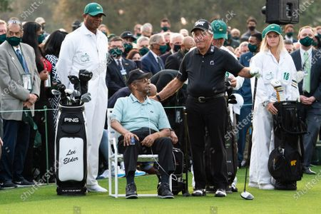 Honorary starters Gary Player stands next to Lee Elder, the first Black man to play in the Masters Tournament, before the start of the 2021 Masters Tournament at the Augusta National Golf Club in Augusta, Georgia on Thursday, April 8, 2021.