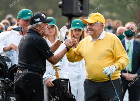 Gary Player and Jack Nicklaus shake hands before hitting the ceremonial tee shot to start the 2021 Masters Tournament at the Augusta National Golf Club in Augusta, Georgia on Thursday, April 8, 2021.