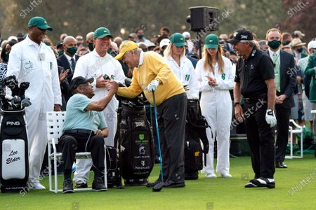 Jack Nicklaus shakes hands with Lee Elder, the first Black man to play the Masters Tournament, as Gary Player watches at the start of the 2021 Masters Tournament at the Augusta National Golf Club in Augusta, Georgia on Thursday, April 8, 2021. Photo by Kevin Dietsch/UPI