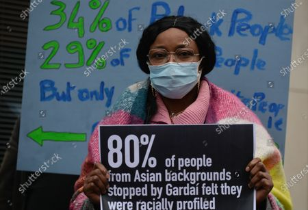 An activist holds a placard during a protest outside the GSOC (Garda Síochána Ombudsman Commission) after today's arrest of George Nkencho's young brother.George Nkencho was shot multiple times by Garda armed support unit outside his home in Clonee, West Dublin, on Wednesday 30 December 2020.On Thursday, April 8, 2021, in Dublin, Ireland.