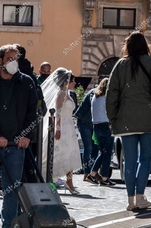 Lady Gaga spotted on the set of The House of Gucci in Rome today. The wedding of patrizia Reggiani and maurizio Gucci at Campitelli Church in Rome