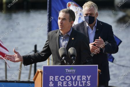 Stock Image of Virginia Gov. Ralph Northam, left, gestures as he speaks during a news conference along with former Gov. and Democratic gubernatorial candidate, Terry McAuliffe, right, at Waterside in Norfolk, Va., . Northam endorsed McAuliffe for Governor