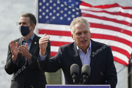 Stock Photo of Former Virginia Gov. Terry McAuliffe, right, gestures during a news conference with Virginia Gov.Ralph Northam, left, at Waterside in Norfolk, Va., . Northam endorsed McAuliffe for Governor