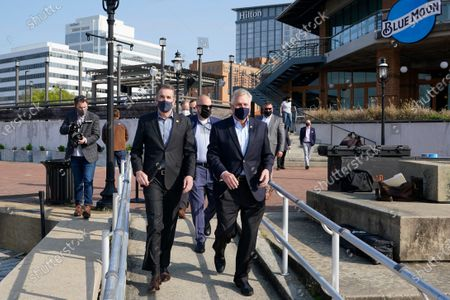 Stock Picture of Virginia Gov. Ralph Northam, left, arrives with former Gov. and Democratic gubernatorial candidate, Terry McAuliffe, right, for a news conference at Waterside in Norfolk, Va., . Northam endorsed McAuliffe for governor