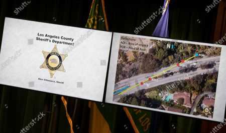 Graphics on monitors detail observations as Los Angeles County Sheriff Alex Villanueva gives reporters an update on the investigation into the crash that seriously injured pro golfer Tiger Woods, during a press conference at the Hall of Justice on Wednesday, April 7, 2021 in Los Angeles, CA. (Brian van der Brug / Los Angeles Times)