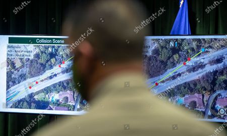 Graphics on monitors as Los Angeles County Sheriff Alex Villanueva gives reporters an update on the investigation into the crash that seriously injured pro golfer Tiger Woods, during a press conference at the Hall of Justice on Wednesday, April 7, 2021 in Los Angeles, CA. (Brian van der Brug / Los Angeles Times)