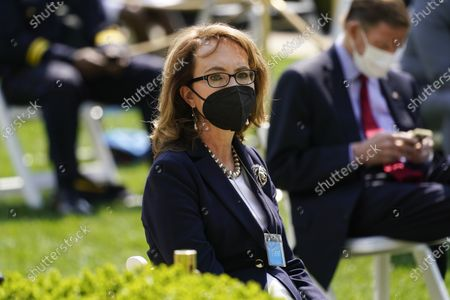 Former Rep. Gabby Gifford, D-Ariz., is seated before an event on gun violence prevention in the Rose Garden at the White House, in Washington