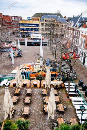 Stock Photo of Closed terraces at the gyros club in the center of The Hague. Terraces and shops may open again from April 21. Chairs and tables are placed on the terrace. The call from Amsterdam mayor Femke Halsema to reopen the terraces and other outdoor spaces in a responsible manner is receiving support from colleagues.