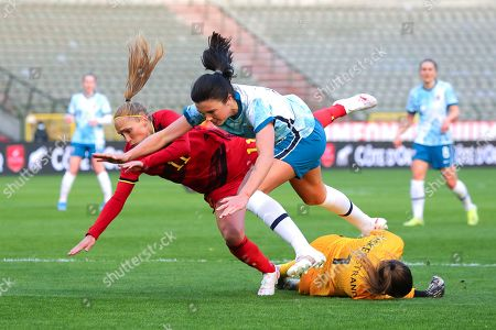Janice Cayman (11) of Belgium with Ingrid Systrad Engen (7) of Norway and goalkeeper Cecilie Fiskerstrand (1) of Norway
