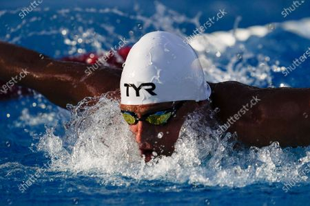 Ryan Lochte competes in the men's 100 meter butterfly prelim at the TYR Pro Swim Series swim meet, in Mission Viejo, Calif
