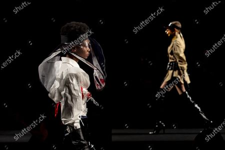 Models display a creation by Maya Hansen during Fashion Week in Madrid, Spain, . The Spanish fashion week takes place from 8 to 11 April under new security measures and social distance guidelines due to the coronavirus pandemic
