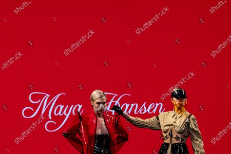 Models display creations by Maya Hansen during Fashion Week in Madrid, Spain, . The Spanish fashion week takes place from 8 to 11 April under new security measures and social distance guidelines due to the coronavirus pandemic