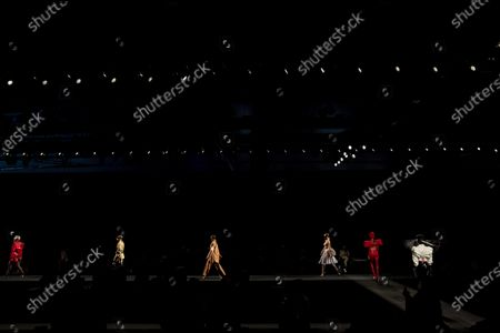 Models display creations by Maya Hansen during the Fashion Week in Madrid, Spain, . The Spanish fashion week takes place from 8 to 11 April under new security measures and social distance guidelines due the coronavirus pandemic