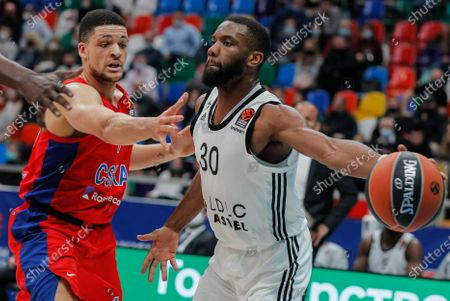 Gabriel Iffe Lundberg (L) of CSKA Moscow in action against Norris Cole (R) of LDLC Asvel Villeurbanne during the Euroleague basketball match between CSKA Moscow and LDLC Asvel Villeurbanne in Moscow, Russia, 08 April 2021.