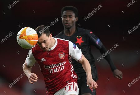 Stock Photo of Arsenal's Cedric Soares (L) in action against Slavia's Oscar Dorley (R) during the UEFA Europa League quarter final, 1st leg match between Arsenal London and Slavia Prague in London, Britain, 08 April 2021.