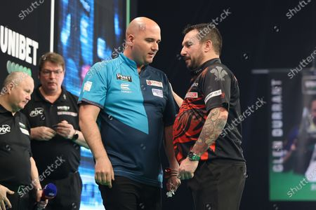Jonny Clayton and Rob Cross after their match during the PDC Premier League darts at Marshall Arena, Milton Keynes