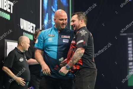 Rob Cross and Jonny Clayton during the PDC Premier League darts at Marshall Arena, Milton Keynes