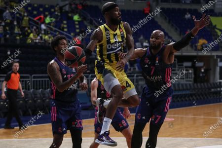 Alex Tyus (R) and Trey Thompkins (L) of Real Madrid in action against Lorenzo Brown (C) of Fenerbahce during the Euroleague basketball match between Fenerbahce Beko and Real Madrid  in Istanbul, Turkey, 08 April 2021.