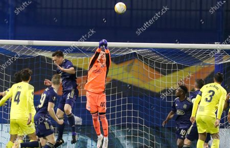 Dinamo Zagreb's goalkeeper Dominik Livakovic punches the ball away during the Europa League, first leg, quarterfinal soccer match between Dinamo Zagreb and Villarreal at the Maksimir stadium in Zagreb, Croatia