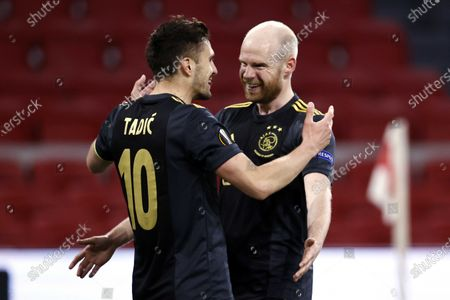Davy Klaassen (R) of Ajax celebrates with teammate Dusan Tadic of Ajax after scoring the 1-0 goal during the UEFA Europa League quarterfinal, 1st leg soccer match between Ajax Amsterdam and AS Roma at the Johan Cruijff Arena in Amsterdam, The Netherlands, 08 April 2021.