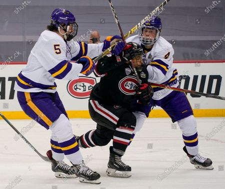 Minnesota State's Jake Jaremko (5) and Andy Carroll (4) with check St. Cloud State's Brady Ziemer during the second period of an NCAA men's Frozen Four hockey semifinal in Pittsburgh