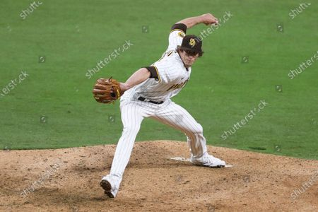 San Diego Padres relief pitcher Tim Hill pitches the ball during a baseball game against the San Francisco Giants, in San Diego