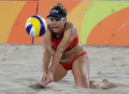The United States' April Ross passes a ball while playing against Brazil during the women's beach volleyball bronze medal match of the 2016 Summer Olympics in Rio de Janeiro, Brazil. Two-time Olympic beach volleyball medalist April Ross has a rare opportunity to relax with 100 days to go before the Tokyo Games. That doesn't mean that she will. Ross and partner Alix Klineman are the No. 1 team in the Olympic qualification rankings and the only Americans who have already clinched one of four likely spots for U.S. beach teams in the pandemic-delayed 2020 Games