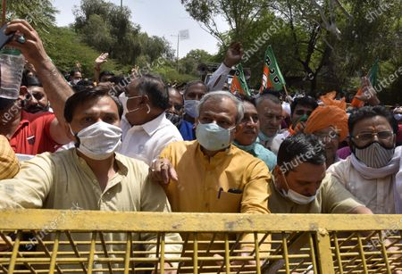 Stock Picture of BJP Delhi President Adesh Gupta and LoP Ramvir Singh Bidhuri lead the Delhi farmers protest near Delhi CM Arvind Kejriwal residence in their demand from Kejriwal government to fulfill their promise of giving an amount 50% above the MSP to farmers on April 8, 2021 in New Delhi, India.