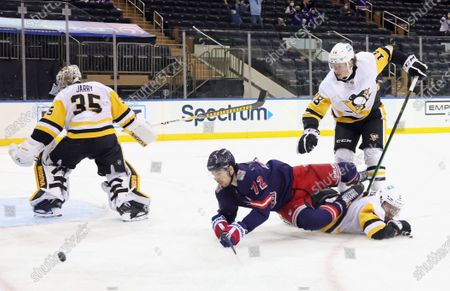 Pittsburgh Penguins' Mike Matheson (5) and Sam Lafferty (18) defend against New York Rangers' Filip Chytil (72) during the second period of an NHL hockey game, in New York