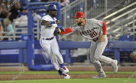 Los Angeles Angels first baseman Jared Walsh (20) tags out Toronto Blue Jays pinch runner Jonathan Davis on a pickoff throw during the ninth inning at TD Ballpark in Dunedin, Florida