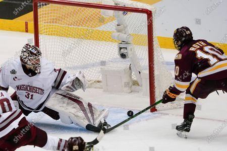 Minnesota-Duluth's Kobe Roth (10) can't get a shot past Massachusetts goaltender Matt Murray (31) during the third period of an NCAA men's Frozen Four hockey semifinal in Pittsburgh