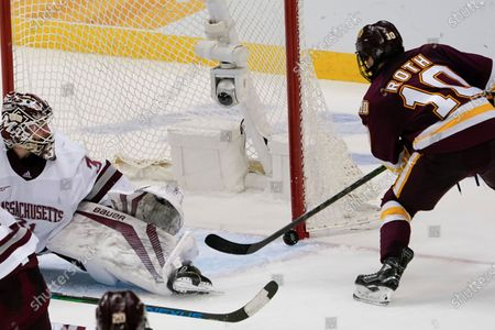Stock Image of Minnesota Duluth's Kobe Roth (10) can't get a shot past Massachusetts goaltender Matt Murray (31) during the third period of an NCAA men's Frozen Four hockey semifinal in Pittsburgh, . Massachusetts won 3-2 in overtime