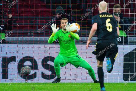 Pau Lopez (AS Roma) stops Dusan Tadic of Ajax penalty