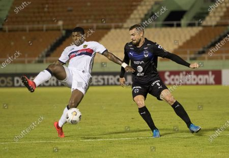 Vincent Janssen from Monterrey (R) disputes the ball with Carlitos Ferreras (L) of Atletico Pantoja during a match of the Concacaf Champions League between Monterrey and Atletico Pantoja at the Felix Sanchez stadium in Santo Domingo, Dominican Republic, 08 April 2021.