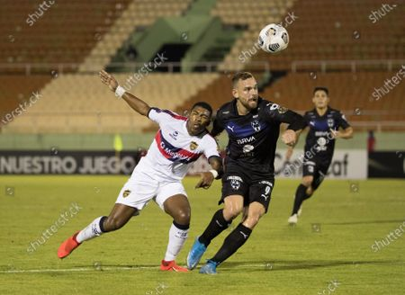 Stock Picture of Vincent Janssen (R) of Monterrey in action against Carlitos Ferreras (L) of Atletico Pantoja during a match of the Concacaf Champions League between Monterrey and Atletico Pantoja at the Felix Sanchez stadium in Santo Domingo, Dominican Republic, 08 April 2021.