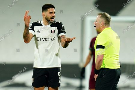 Stock Picture of Aleksander Mitrovic of Fulham complains to referee Jon Moss
