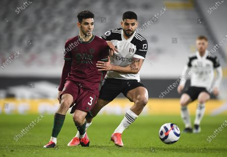 Rayan Aït-Nouri of Wolverhampton Wanderers and Aleksandar Mitrovic of Fulham battle for the ball
