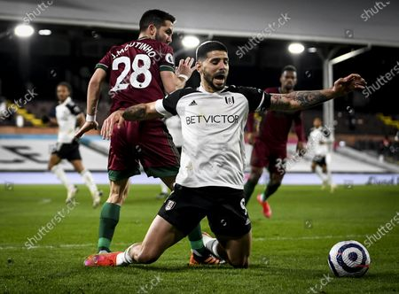 Stock Photo of Aleksandar Mitrovic of Fulham is fouled by João Moutinho of Wolverhampton Wanderers