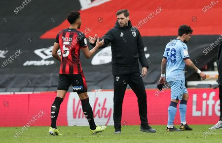 Lloyd Kelly of Bournemouth is congratulated by Bournemouth Manager - Jonathan Woodgate (Interim) after a 4-1 victory