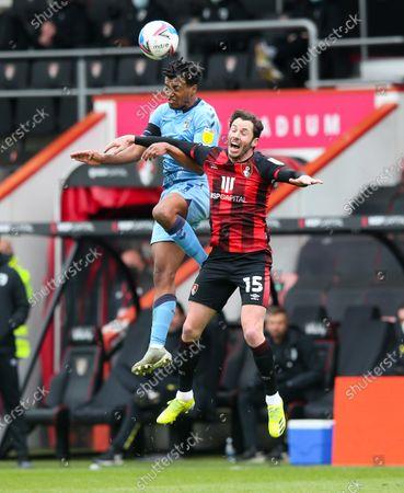 Sam McCallum of Coventry City & Adam Smith of Bournemouth compete for a header