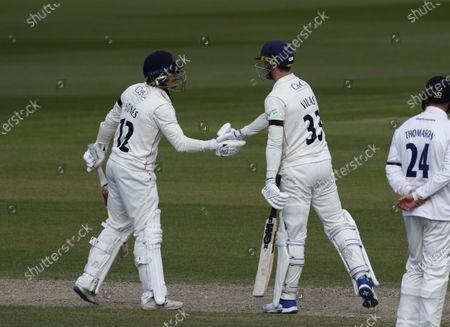 Rob Jones and Dane Vilas of Lancashire celebrate their hundred partnership; Emirates Old Trafford, Manchester, Lancashire, England; English County Cricket, Lancashire versus Sussex.