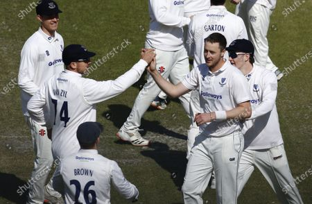 Ollie Robinson of Sussex celebrates with Stiaan van Zyl after he has Keaton Jennings of Lancashire caught by Aaron Thomason for 4; Emirates Old Trafford, Manchester, Lancashire, England; English County Cricket, Lancashire versus Sussex.