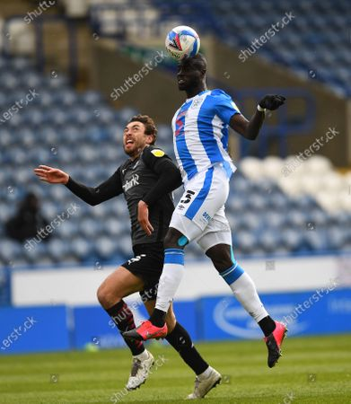 Matthew Olosunde of Rotherham United and Danny Ward of Huddersfield Town