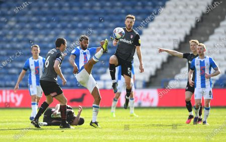 Stock Image of Fraizer Campbell of Huddersfield Town and Lewis Wing of Rotherham United
