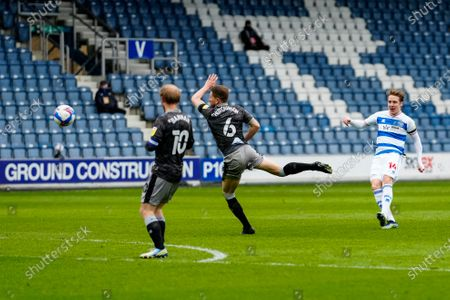 Stefan Johansen of QPR strikes the ball past Sam Hutchinson of Sheffield Wednesday and Barry Bannan of Sheffield Wednesday to score a goal and make it 2-1