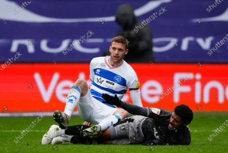 Sam Field of QPR collides with Joost van Aken of Sheffield Wednesday
