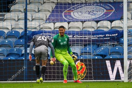 Seny Dieng of QPR reacts following a challenge by Jordan Rhodes of Sheffield Wednesday