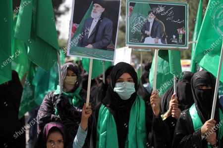 Supporters of Gulbuddin Hekmatyar, the reconciled leader of Hizb-e-Islami, attend a rally as they demand the resignation of President Ashraf Ghani for his alleged failure to fix the security situation and disruption of the peace process, in Herat, Afghanistan, 09 April 2021. Afghan President Ashraf Ghani on 07 April 2021 set forth his three-step proposal, including a political agreement between his government and the Taliban, subject to ratification by a Loya Jirga (grand assembly), to be followed by an internationally monitored cease-fire, for ending the decades-long conflict in his country ahead of this month's peace conference in Turkey.