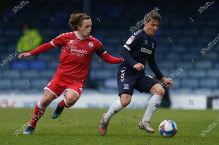 Sam Matthews of Crawley Town (20) and Tom Clifford of Southend United (12)